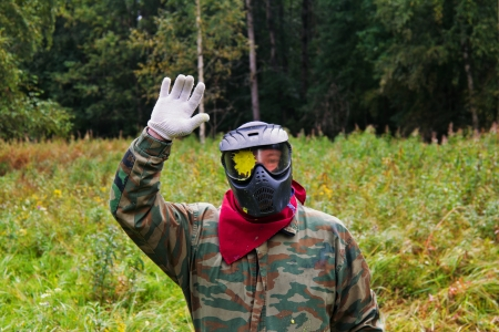 Paintball players in full gear at the shooting range photo