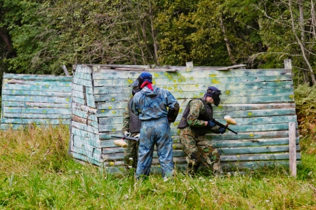 15237708: Paintball players in full gear at the shooting range