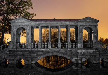 Marble bridge in Puskin Park at sunset