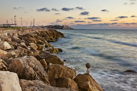 The Tel Aviv promenade at sunset The lights of Jaffa at sunset photo
