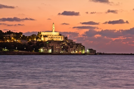 The Tel Aviv promenade at sunset The lights of Jaffa at sunset Stock Photo - 15854729
