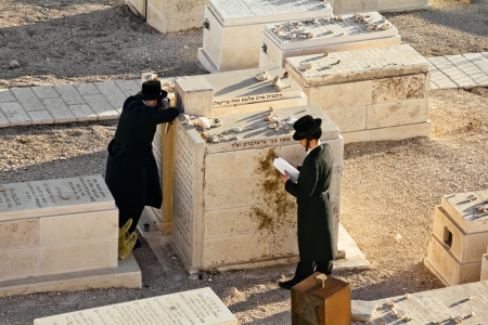 Jews pray at the graves of ancestors on the Mount of olives in Jerusalem