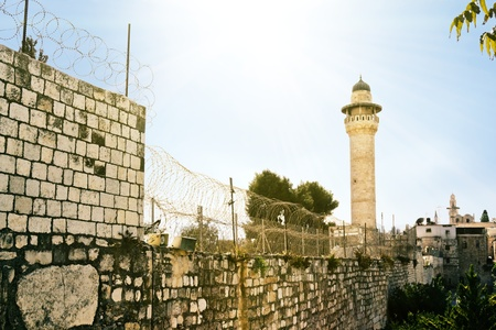 wrapped barbed wire fence of the Muslim quarter in the old city of Jerusalem wrapped barbed wire fence of the Muslim quarter in the old city of Jerusalem Stock Photo - 16528923