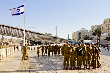 A squad of Israeli soldiers on the square near the Western Wall under national flag  Jerusalem  Stock Photo