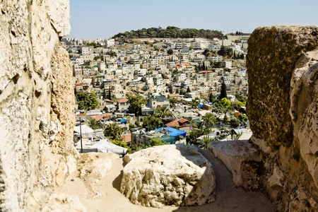 View from the walls of ancient Jerusalem  to neighborhoods and city rooftops photo