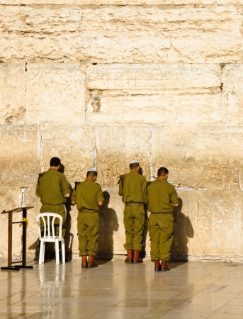 The soldiers of the Israeli army are praying at the Western Wall in Jerusalem