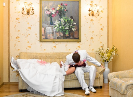 Groom kissing bride lying on his lap Stock Photo