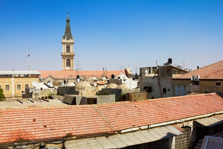 View from the walls of ancient Jerusalem  to neighborhoods and city rooftops Stock Photo - 17919297