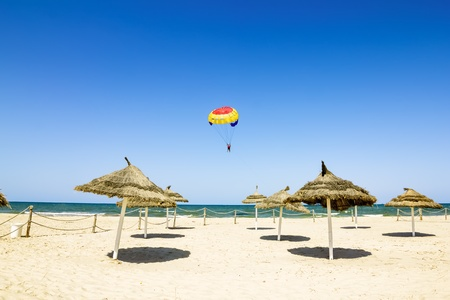 Parachute flies over the Mediterranean Sea and the beaches of Tunisia