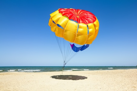 parasailing: Parasailing on the beach of the Mediterranean in Tunisia Stock Photo