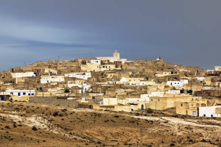 The town Matmata in Tunisia amid lightning sky photo