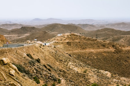 Mountain landscape at the town Matmata in Tunisia photo