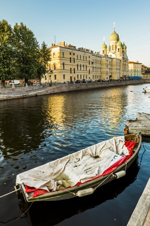 View of the St  Isidorovsky Church in St  Petersburg and the boats on the Canal Griboedova