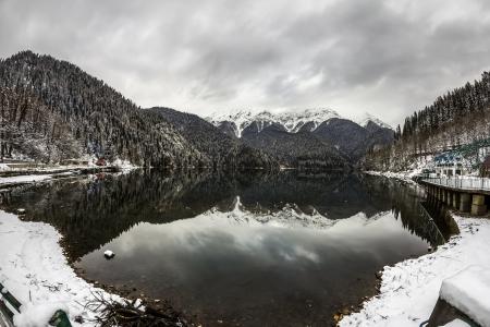 abkhazia: Alpine Lake Ritsa in winter under gloomy clouds, Abkhazia