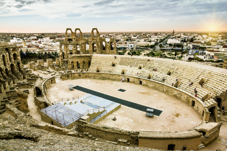 Types of Roman amphitheatre in the city of El JEM in Tunisia amid dramatic sky