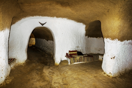 Underground House of trogladites in the desert of Tunisia,Matmata Stock Photo