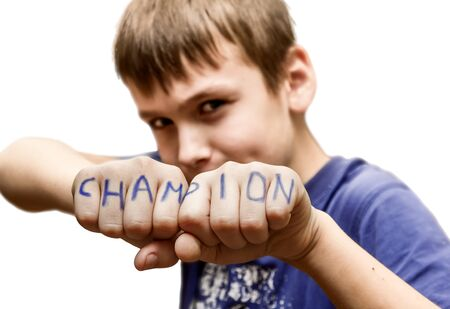 A boy stands in a fighting pose, with the words  champion  on your toes on a white background