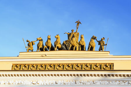Sculpture on the Arch of the General staff building on Palace Square in Saint Petersburg in sunny day photo