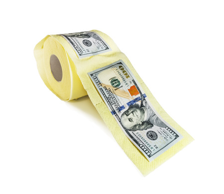 one hundred dollar bills on a roll of toilet paper on a white background photo