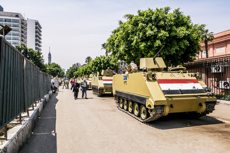 Armoured vehicles and soldiers in front of the burned-out buildings of the Government and the National Museum in Cairo, April 13, 2014,Egypt
