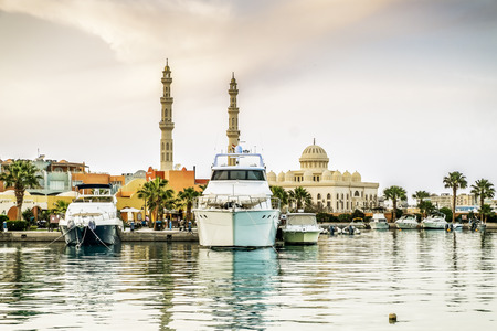 ported: Yachts berthed at the port of Hurghada, Hurghada Marina at sunset against the mosque, April 15, 2014,Egypt