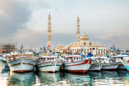 Yachts berthed at the port of Hurghada, Hurghada Marina at sunset against the mosque, April 15, 2014,Egypt