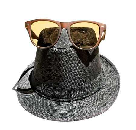 Black Hat with brown sunglasses on a white background photo