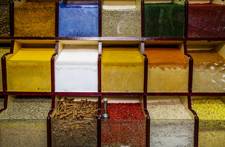 Counter with different spices and seasonings in the Eastern market photo