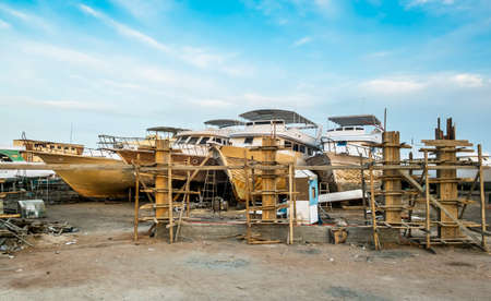 ported: Old boats are being repaired on the shore at the port of Hurghada Egypt Stock Photo