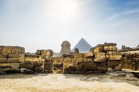 cheops: The Sphinx and the pyramid of Cheops in Giza in the background of a Sun Cairo Giza