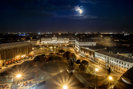 View of the square in front of the St Isaac's Cathedral at Moonlight night in St.-Petersburg