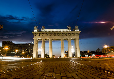 irradiation: Moscow triumphal gates in Moscow Avenue in St. Petersburg in the evening illumination Editorial