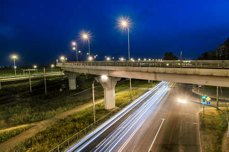 crossway: headlights racing machines.The ring road interchange in St. Petersburg at evening illumination