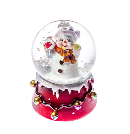 Christmas toy snowman in glass ball ,isolated on white background Stock Photo