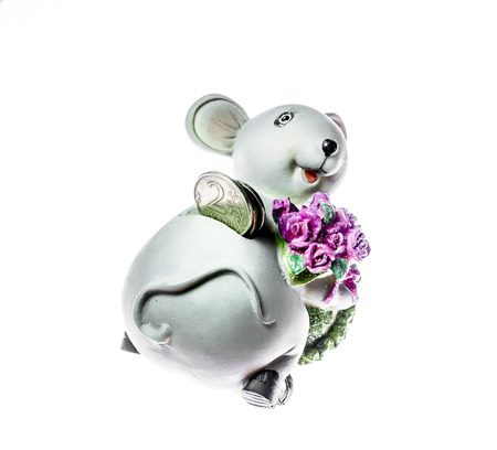 Piggy in the form of a mouse with the inserted coins isolated on white background photo
