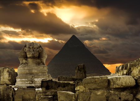 cheops: The Sphinx and the pyramid of Cheops in Giza in the background of a sky, Cairo, Giza Stock Photo