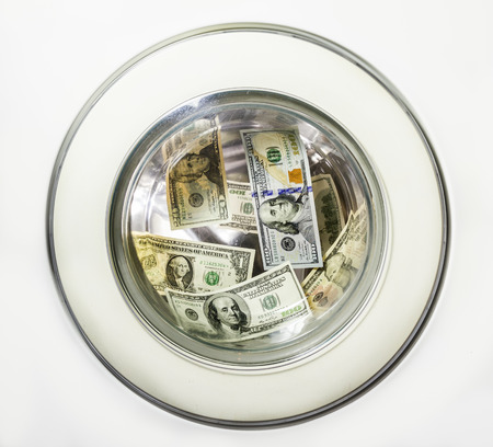 Dollar bills is washed in the washing machine drum photo