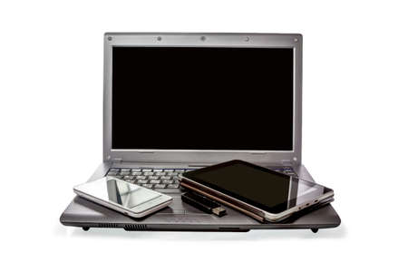 Smartphone, USB flash drive, the Tablet and laptop, isolated on white background photo