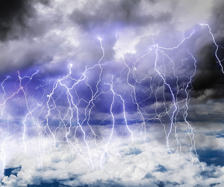 dazzle: Black clouds in the sky full of lightning in a thunderstorm with a roll of Thunder