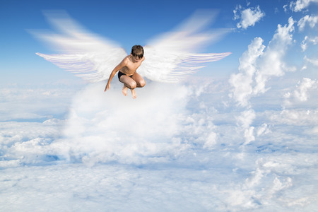 angel alone: boy with Angel Wings flying around in the sky above the clouds
