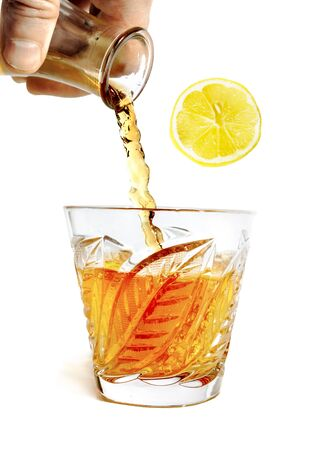 whiff: whiff of alcohol pours with splashes into the glass isolated on white background Stock Photo