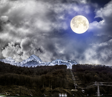 panoramas: Panoramas of mountains, mountain ski lifts at Krasnaya Polyana in the light of the full moon, Sochi, Russia Stock Photo
