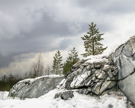 harsh: Harsh northern Misty landscape. Ruskeala marble quarries in Karelia, Russia in winter Stock Photo