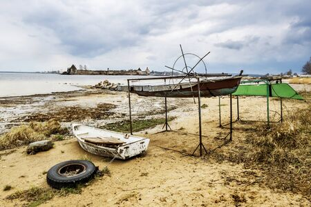 ladoga: fishing Boats on the shore of the Ladoga Lake in rainy weather in St. Petersburg Russia
