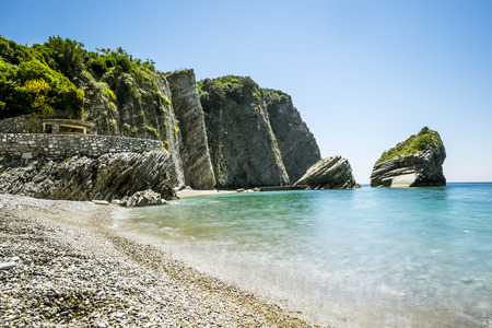 The beach and the cliffs on the island of St. Nicholas in Budva, Montenegro.Paradise beach on an island in the sea
