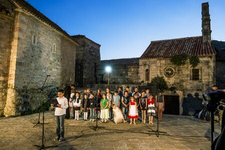 pentecost: May 31, 2015.Childrens Choir performs at Pentecost in the old town of Budva, Montenegro