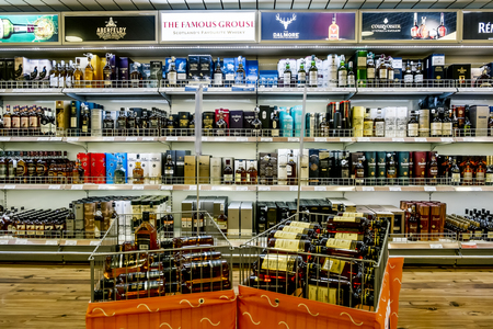 intoxicating: January 4, 2016. Showcases the alcohol in the duty free shop on the ferry Tallink Romantica. Tallinn. Estonia.