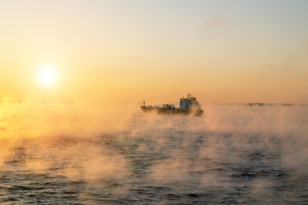 winter: January 5, 2016.Of the Baltic sea. The ship sails at dawn in the fog of the cold winter sea.Estonia Editorial