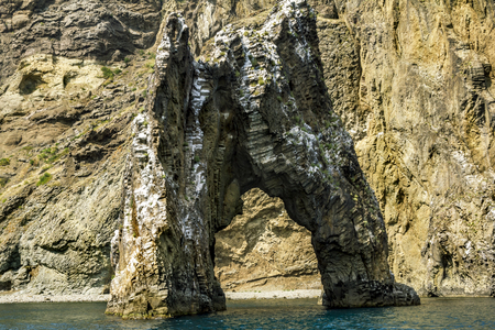 rock arch: Rock arch in the waters of the Black sea in the national Park of Kara Dag.Crimea.Ukraine Stock Photo