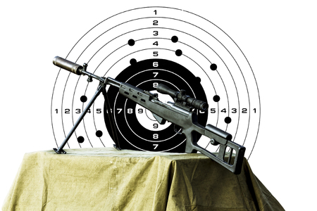 rifleman: Charged sniper rifle isolated on a white background with a hole in the target Stock Photo